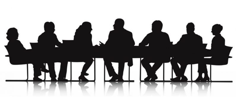 Silhouette of a group of participants meeting as a board