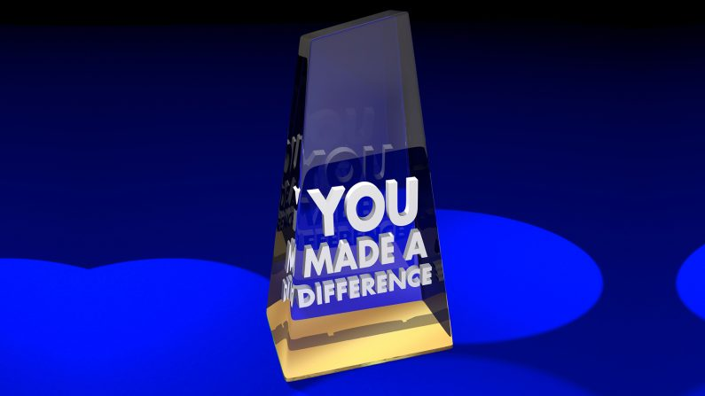 Thank you to our Conservative Volunteers - award motif with glass award with blue spotlights in the background